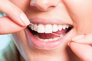 Person Flossing Teeth | Middletown NJ Dentist