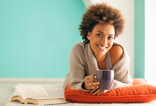 Smiling Woman Holding Coffee Cup | Dentist Middletown NJ